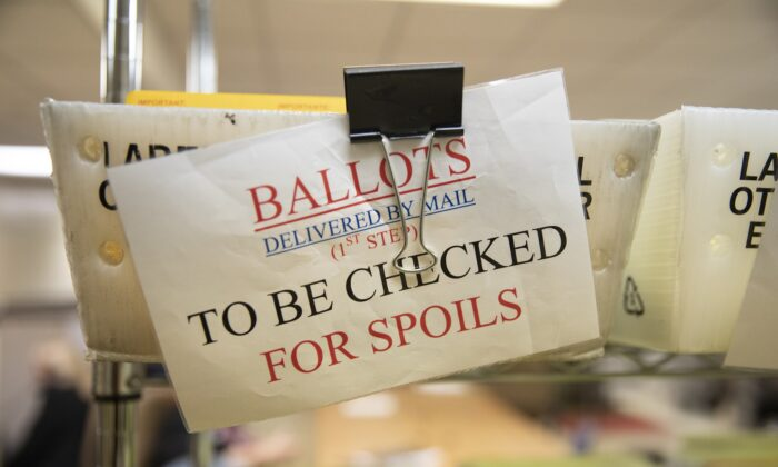Mailed in ballots sit in U.S. Postal Service bins inside the office of the Stanislaus County Clerk in Modesto, Calif. on Nov. 6, 2018. (Alex Edelman/Getty Images)