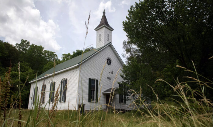 Five years after shutting its doors for good, the Enon Baptist Church stands on the precipice of either returning to the soil or finding an enterprising buyer to plunk down $50,000 and bring it back to a new life. (Justin Merriman)