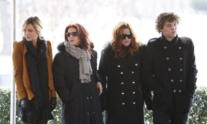 Priscilla Presley, second from left, her daughter, Lisa Marie Presley, second from right, and Lisa Marie's children, Riley Keough, left, and Benjamin Keough, right, take part in a ceremony commemorating Elvis Presley's 75th birthday in Memphis, Tenn., on Jan. 8, 2010. (Mark Humphrey/AP Photo)