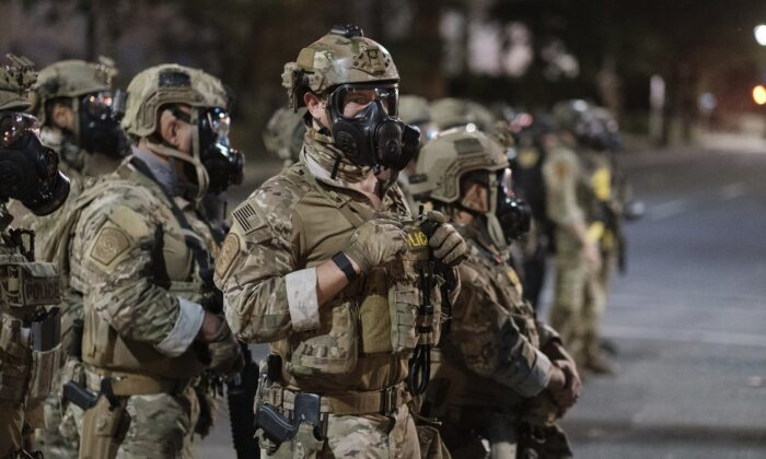 Agents from different components of the Department of Homeland Security are deployed to protect a federal courthouse in Portland, Ore., on July 5, 2020. (Doug Brown via AP)