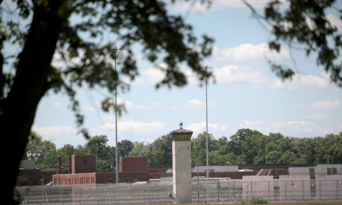 A guard tower sits along a security fence at the Federal Correctional Complex in Terre Haute, Ind., on July 13, 2020. (Scott Olson/Getty Images)