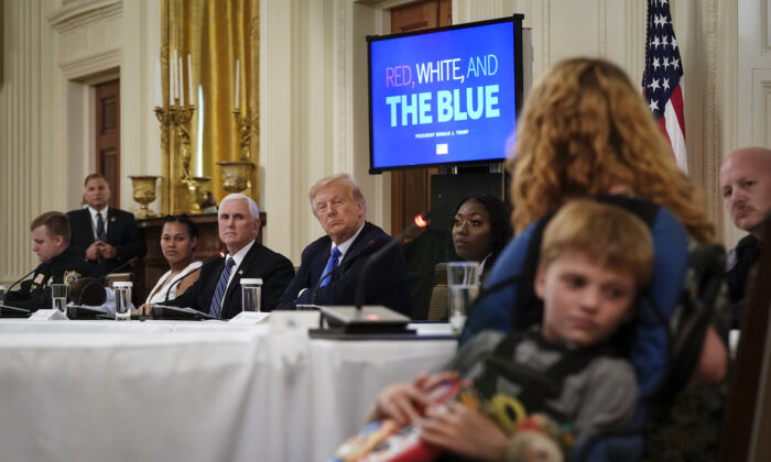 President Donald Trump listens during an event about citizens positively impacted by law enforcement, in the East Room of the White House in Washington, on July 13, 2020. (Drew Angerer/Getty Images)