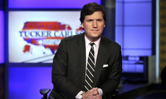 Tucker Carlson poses for photos in a Fox News Channel studio, in New York on March 2, 2017. (Richard Drew/AP Photo)