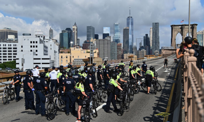 People get arrested on the Brooklyn Bridge after about a dozen Black Lives Matter protesters briefly shut down the bridge in New York City, on July 15, 2020. (Angela Weiss/AFP via Getty Images)