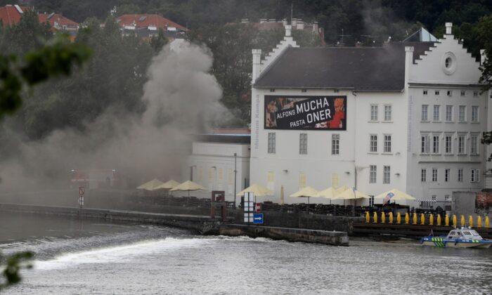 Smokes rises from a technical building of the Kampa Museum in Prague, Czech Republic, on July 15, 2020.(Petr David Josek/AP Photo)
