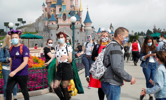 First visitors arrive at Disneyland Paris as the theme park reopens its doors to the public in Marne-la-Vallee, near Paris, following the coronavirus disease (COVID-19) outbreak in France, July 15, 2020. (Charles Platiau/Reuters)
