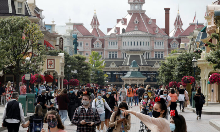 First visitors arrive at Disneyland Paris as the theme park reopens its doors to the public in Marne-la-Vallee, near Paris, following the coronavirus disease (COVID-19) outbreak in France, on July 15, 2020. (Charles Platiau/Reuters)