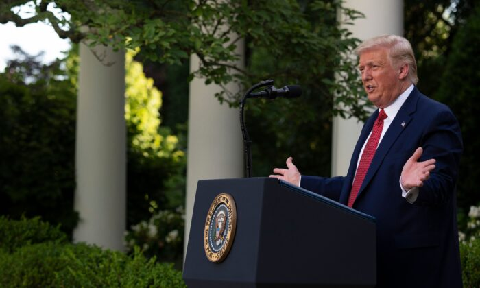 President Donald Trump gestures as he delivers a press conference in the Rose Garden of the White House on July 14, 2020. (Jim Watson/AFP via Getty Images)