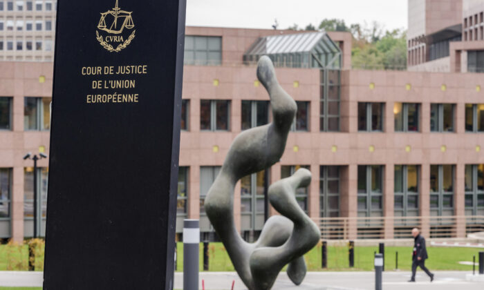 A man walks by the European Court of Justice in Luxembourg on Oct. 5, 2015. The European Union's top court ruled that an agreement that allows big tech companies to transfer data to the United States is invalid, and that national regulators need to take tougher action to protect the privacy of users' data. July 16, 2020. (Geert Vanden Wijngaert/AP Photo)