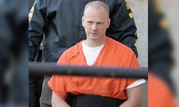 Dustin Lee Honken is led by U.S. Marshals into the Federal Courthouse in Cedar Rapids, Iowa, prior to his sentencing, on Oct. 11, 2005. (Cliff Jette/File/The Gazette via AP)