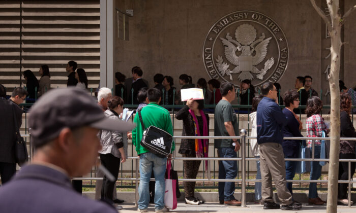 Chinese citizens wait in line to submit their visa applications at the U.S. Embassy in Beijing, China, on April 27, 2012. (Ed Jones/AFP/GettyImages)