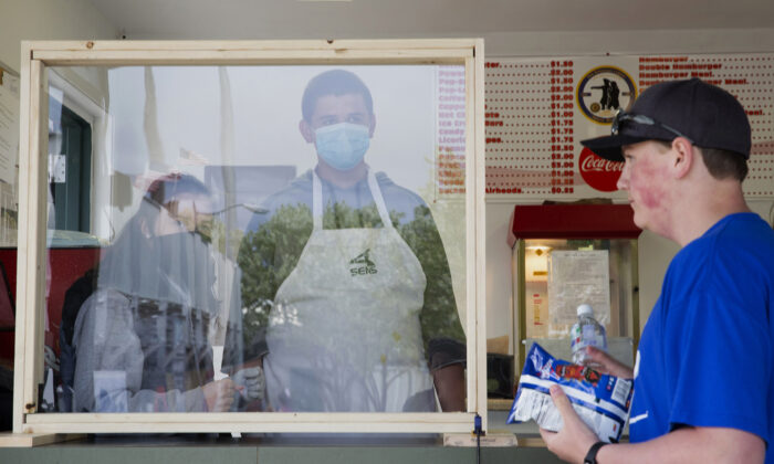 Concession stand employees wait on a customer in Helena, Mont., on May 21, 2020. (Janie Osborne/Getty Images)
