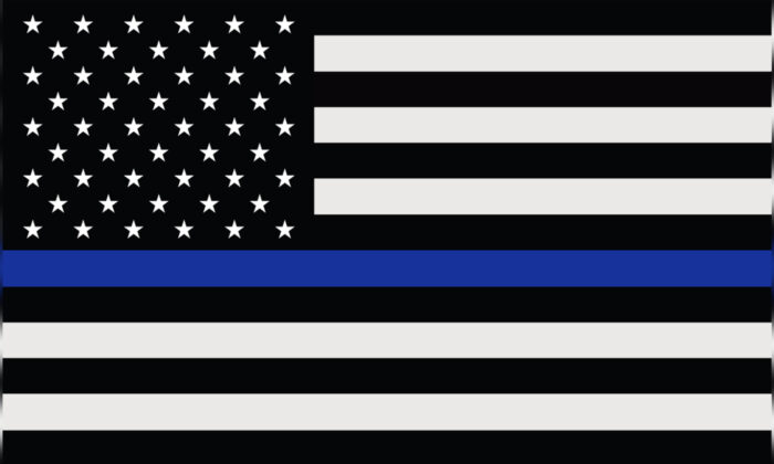 """The """"Thin Blue Line"""" flag, a symbol of support and solidarity for American law enforcement. (Borka Kiss/Shutterstock)"""
