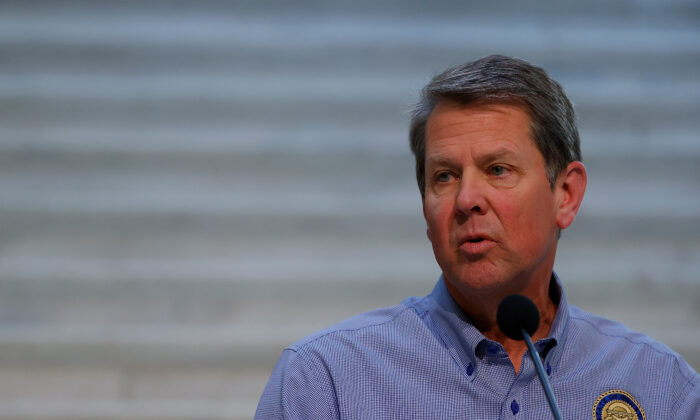 Georgia Governor Brian Kemp speaks to the media during a press conference at the Georgia State Capitol in Atlanta, Ga., on April 27, 2020. (Kevin C. Cox/Getty Images