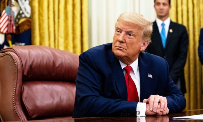 "President Donald Trump addresses reporters in the Oval Office of the White House after receiving a briefing from law enforcement on ""Keeping American Communities Safe: The Takedown of Key MS-13 Criminal Leaders"" on July 15, 2020 in Washington. (Anna Moneymaker-Pool/Getty Images)"