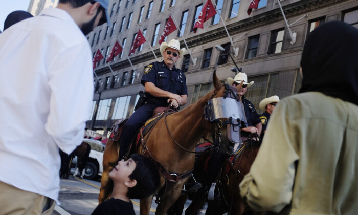 A young boy and his family members look at the horses of the Fort Worth, Texas, mounted police on the third day of the Republican National Convention in Cleveland, Ohio, on July 20, 2016. (Dominick Reuter/AFP via Getty Images)