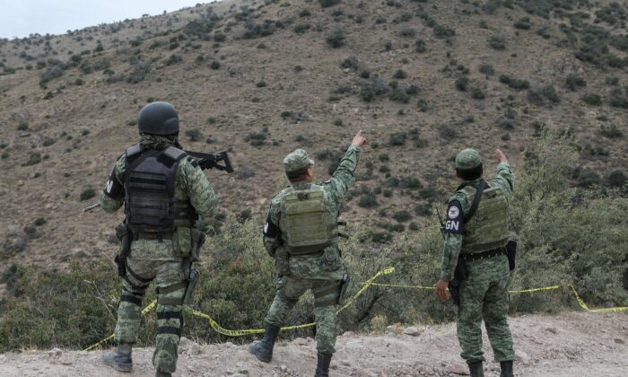 Members of the National Guard patrol the Sonora mountain range, where nine members of the LeBaron community were killed on Monday in the municipality of Bavispe, Sonora state, Mexico, on Nov. 8, 2019. (Herika Martinez/AFP via Getty Images)