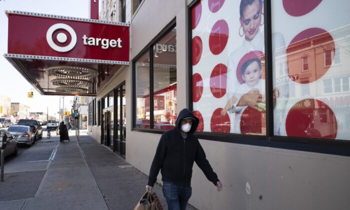 In this April 6, 2020 file photo, a customer wearing a mask carries his purchases as he leaves a Target store during the coronavirus pandemic in the Brooklyn borough of New York. (Mark Lennihan/AP Photo)