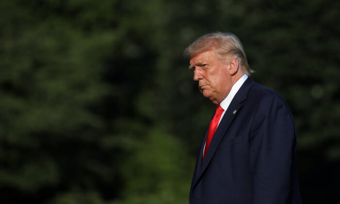 President Donald Trump returns from his travel to Atlanta, on the South Lawn of the White House on July 15, 2020. (Carlos Barria/Reuters)