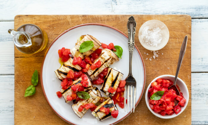 For this quintessential Mediterranean appetizer, stuff grilled eggplant slices with herby ricotta and dress them with fresh tomatoes. (Photo by Giulia Scarpaleggia)