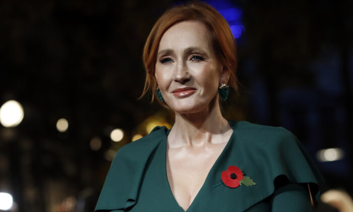 """Writer J.K. Rowling poses for the media at the world premiere of the film """"Fantastic Beasts: The Crimes of Grindelwald"""" in Paris on Nov. 8, 2018. Dozens of artists, writers and academics have signed an open letter decrying the weakening of public debate, it was announced Wednesday, July 8, 2020 warning that the free exchange of information and ideas is in jeopardy. J.K. Rowling, Salman Rushdie and Margaret Atwood are among dozens of writers, artists and academics to argue against ideological conformity in an open letter in Harper's Magazine. The letter comes amid a debate over so-called cancel culture—where prominent people face attack for sharing controversial opinions. (Christophe Ena/AP Photo)"""