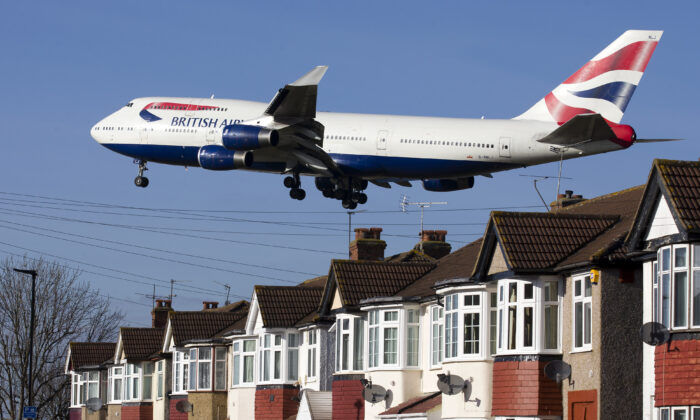 A British Airways 747 aircraft flies over roof tops as it comes into lane at Heathrow Airport in west London on Feb. 18, 2015. (Justin Tallis/AFP via Getty Images)