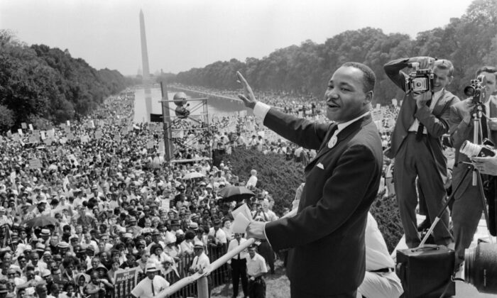 The civil rights leader Martin Luther King Jr. (C) waves to supporters on the Mall in Washington on Aug. 28, 1963. (-/AFP via Getty Images)