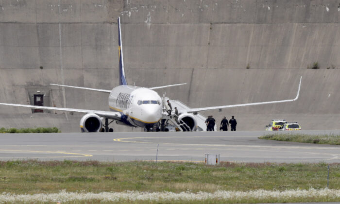 A picture taken on July 17, 2020, shows an aircraft of Irish low-cost carrier Ryanair on the tarmac of the Gardemoen airport about 50 km (30 miles) northeast of the Norwegian capital, where the aircraft landed safely after a bomb threat. (Berit Roald/NTB Scanpix/AFP via Getty Images)
