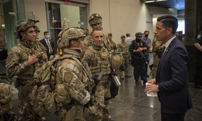 Acting Department of Homeland Security Secretary Chad Wolf meets with federal officers in Portland in an undated photograph released July 17, 2020. (Department of Homeland Security)