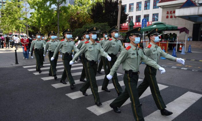 Paramilitary police officers patrol in a shopping area on the closing day of the Chinese People's Political Consultative Conference (CPPCC) in Beijing on May 27, 2020. (Greg Baker/AFP via Getty Images)
