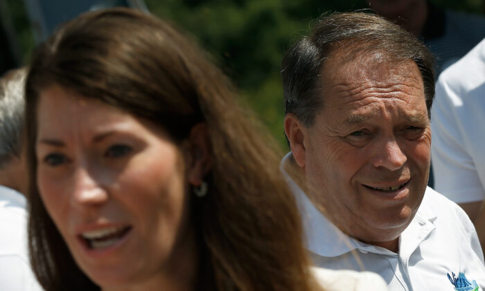 Kentucky's Democratic U.S. Senate nominee, and Kentucky Secretary of State, Alison Lundergan Grimes (L) greets supporters at the opening of her Paducah campaign office as her father Jerry Lundergan (R) looks on, in Paducah, Ky., on Aug. 1, 2014. (Win McNamee/Getty Images)