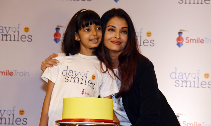 Indian Bollywood actress Aishwarya Rai Bachchan (R) poses with her daughter Aaradhya Bachchan during a birthday event with NGO Smile Train India in honour of her late father, Krishnaraj Rai, in Mumbai on Nov. 20, 2018. (-/AFP via Getty Images)