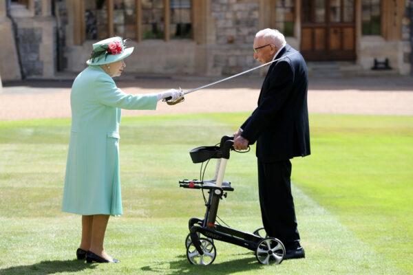 Britain's Queen Elizabeth awards Captain Tom Moore
