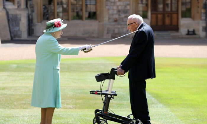 Britain's Queen Elizabeth awards Captain Tom Moore with the insignia of Knight Bachelor at Windsor Castle, in Windsor, Britain, on July 17, 2020. (Chris Jackson/Pool via Reuters)