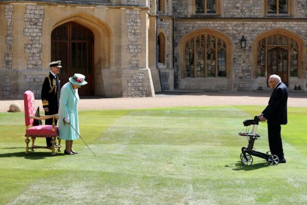 Britain's Queen Elizabeth awards Captain Tom Moore -1