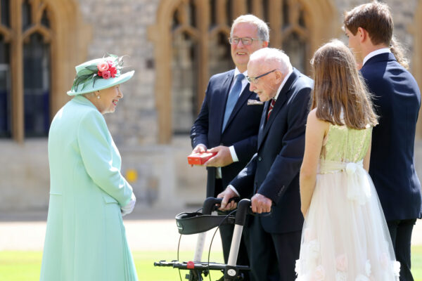 Britain's Queen Elizabeth talks to Captain Tom Moore and his family