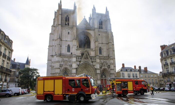 Fire fighters brigade work to extinguish the blaze at the Gothic St. Peter and St. Paul Cathedral, in Nantes, western France on July 18, 2020. (Laetitia Notarianni/AP Photo)