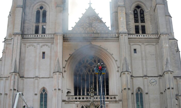 French firefighters battle a blaze at the Cathedral of Saint Pierre and Saint Paul in Nantes, France, on July 18, 2020. (Stephane Mahe/Reuters)