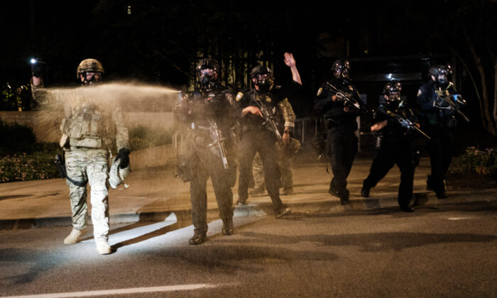 Federal officers use tear gas and other crowd dispersal munitions on violent demonstrators in Portland, Ore., on July 17, 2020. (Mason Trinca/Getty Images)