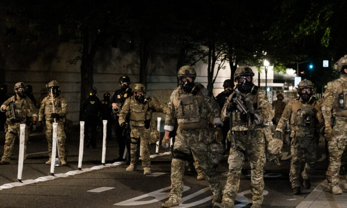 Federal officers prepare to disperse a crowd outside the Multnomah County Justice Center in Portland, Ore., on July 17, 2020. (Mason Trinca/Getty Images)