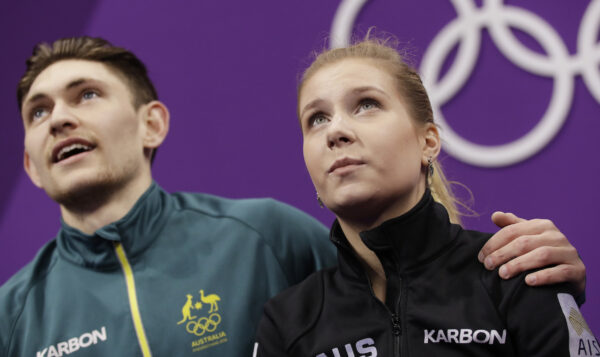 Ekaterina Alexandrovskaya and Harley Windsor of Australia watch as their scores