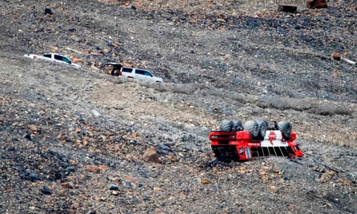RCMP work on the scene of a sightseeing bus rollover at the Columbia Icefields near Jasper, Alta., on July 19, 2020. (Jeff McIntosh/The Canadian Press)