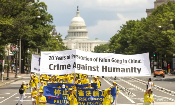 Falun Gong practitioners take part in a parade commemorating the anniversary of the persecution of Falun Gong in China, in Washington on July 18, 2019. (Samira Bouaou/The Epoch Times)