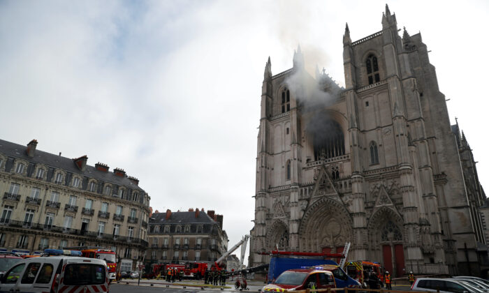 French firefighters gather at the scene of a blaze at the Cathedral of Saint Pierre and Saint Paul in Nantes, France, on July 18, 2020. (Stephane Mahe/Reuters)
