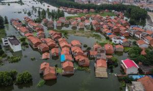 Historic Flooding Wreaks Havoc on Large Swathes of Southern China