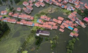 Dam Destroyed in Flood Emergency; 2nd Flood Wave arrives on Yangtze River; Xinjiang Virus Unrest