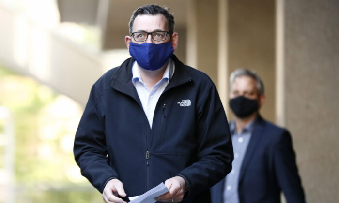 Victorian Premier Daniel Andrews wears a face mask as he walks in to the daily briefing in Melbourne, Australia on July 19, 2020. (Darrian Traynor/Getty Images)