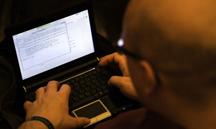 A man at the computer on Dec. 27, 2011. (Adam Berry/Getty Images)