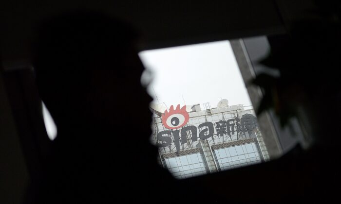 Signage of Sina Weibo (C), widely known as China's version of Twitter, is displayed in Beijing on April 16, 2014. (WANG ZHAO/AFP via Getty Images)