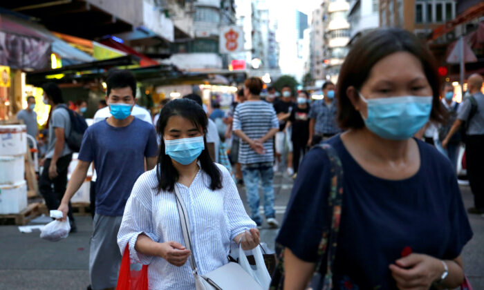 People wear surgical masks at a wet market following the COVID-19 outbreak at Sham Shui Po, one of the oldest districts in Hong Kong on July 17, 2020.  (Tyrone Siu/Reuters)